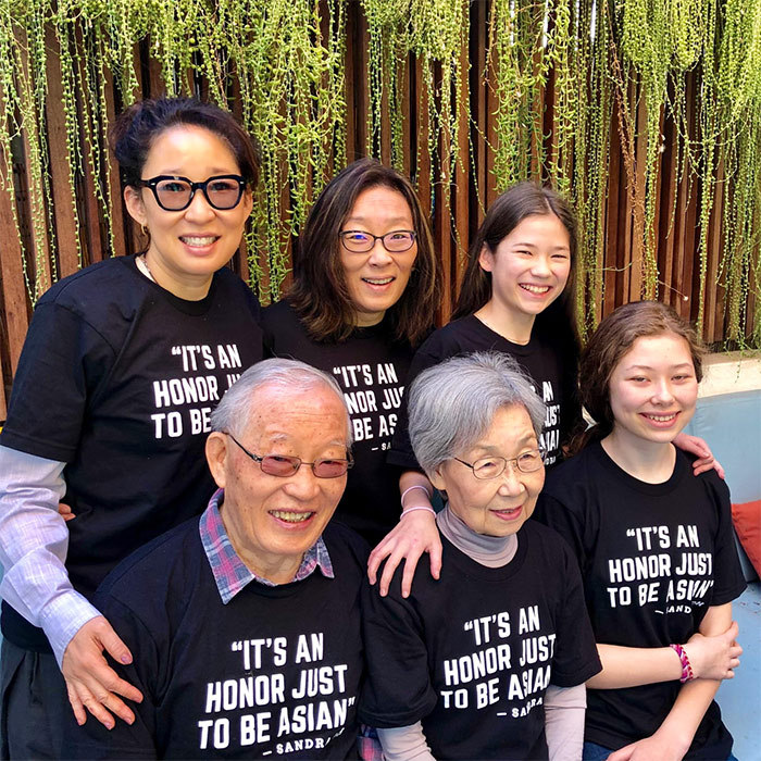"Host and nominee Sandra Oh posed with her family, all wearing matching T-shirts. ""Thank you beloved family (ps—why are mom and dad not looking at camera?),"" she captioned the image.