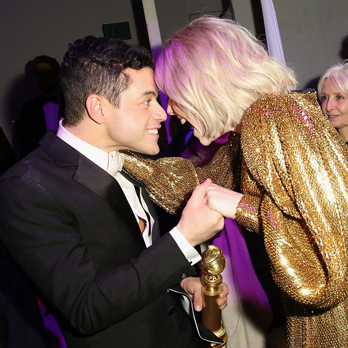 Rami Malek and his girlfriend Lucy Boynton celebrated the <em>Bohemian Rhapsody</em> star's win at the FOX/HULU post-show celebration.
