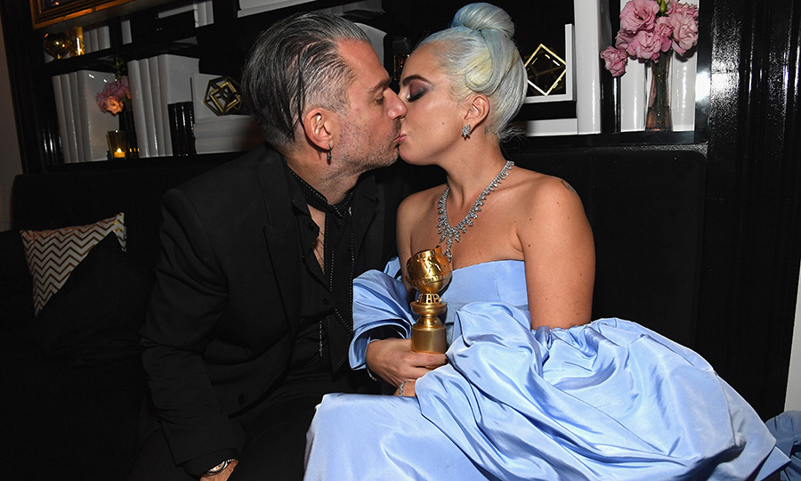 "A star was certainly born that night! Though she didn't take home the award for best actress for her role in <em>A Star Is Born</em>, her motion picture song ""Shallow"" did! Lady Gaga shared a sweet smooch with her fiancé Christian Carino at the InStyle and Warner Bros. shindig.