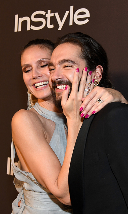 Heidi Klum and fiancé Tom Kaulitz cheesed for the cameras at the InStyle and Warner Bros. after party! The mother of four showed off her amazing engagement ring.