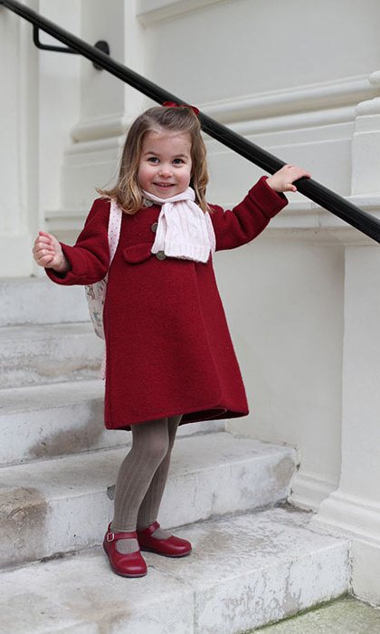 "The royal cutie clearly has her poses down! ""The Duke and Duchess of Cambridge are very pleased to share two photographs of Princess Charlotte at Kensington Palace this morning,"" the palace said of the snaps. ""The images were taken by The Duchess shortly before Princess Charlotte left for her first day of nursery at the Willcocks Nursery School.""
