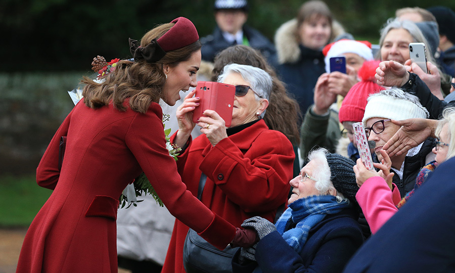 It's one of the most exciting outings of the year for royal watchers, and Duchess Kate didn't disappoint! Joining other members of the Royal Family for Christmas Day services at Sandringham, Kate stunned in a berry hued coat dress paired with a burgundy topper by – you guessed it! – Jane Taylor. The headband featured another of the mother of three's current obsessions: velvet bows!