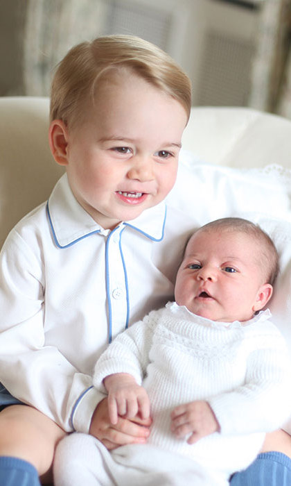 Princess Charlotte looks like she's holding her big brother's hand!
