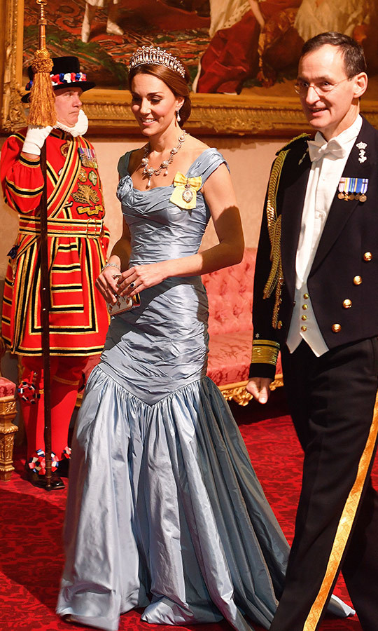 For a state banquet honouring King Willem-Alexander and Queen Maxima of the Netherlands in October 2018, Duchess Kate dazzled in a new design by Alexander McQueen - an icy blue mermaid-style gown with a gathered bodice and off-the-shoulder neckline. She topped it off with a treasure trove of historic baubles: Queen Alexandra's 19th century Wedding Parure necklace, Princess Diana's Collingwood pearl earrings and her favourite Cambridge Lover's Knot tiara. The piece de resistance? Her Royal Family Order – a very prestigious honour that many countries have within their own royal families. Kate's, from Her Majesty, boasts a portrait of the Queen surrounded by diamonds on a yellow ribbon. 