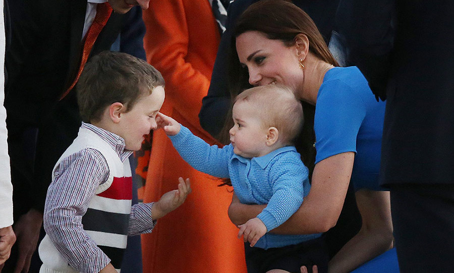 The playful Prince reached out to touch a young boy's face as the royal tour continued in Canberra – and of course, his loving mom obliged!