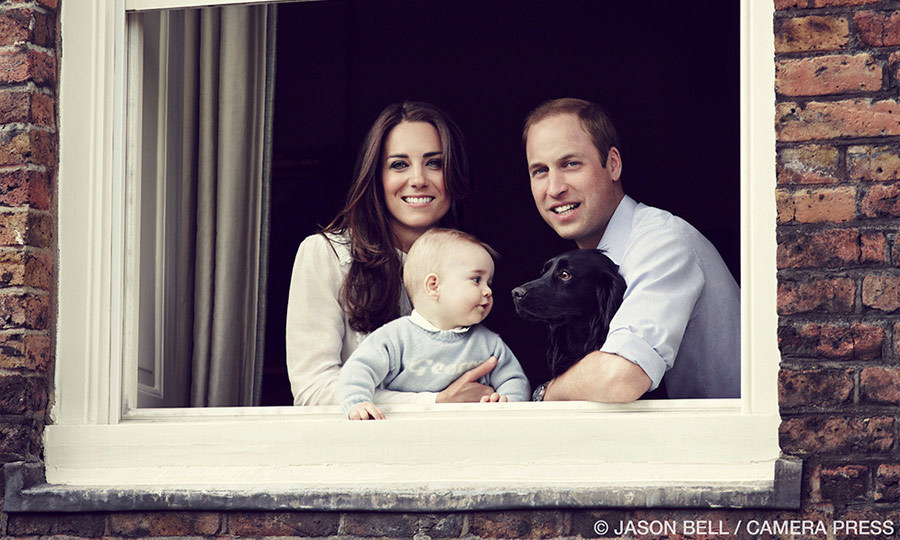 William and Kate released a new family photo before embarking on their royal tour of New Zealand and Australia in 2014. Captured by Jason Bell at the couple's London residence Kensington Palace, it shows eight-month-old George carefully being held by his mother as he stared inquisitively at the family's pet spaniel Lupo.