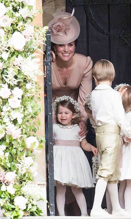 The little royal burst out in a smile when she saw her aunt arrive in her beautiful Giles Deacon dress. Kate couldn't contain her happiness either!