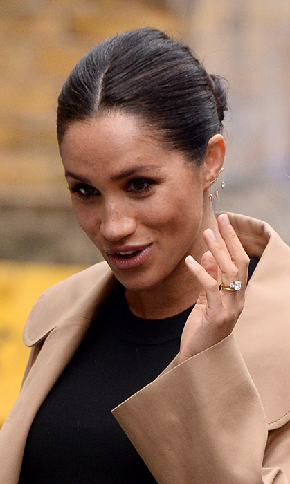 Ever the style starter, Meghan wore a very unique bar earring by Kimai Felicity. The accessory, which climbed her left earlobe, features three dangly accents. She also showed off her stunning engagement ring, of course!