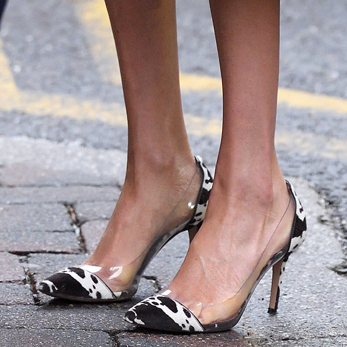 Veering away from her go-to Aquazzura pumps, the mom-to-be dazzled in a new pair of heels – the Gianvito Rossi Cow Print Plexi Heels, which feature a fashion-forward cow print and chic transparent sides.