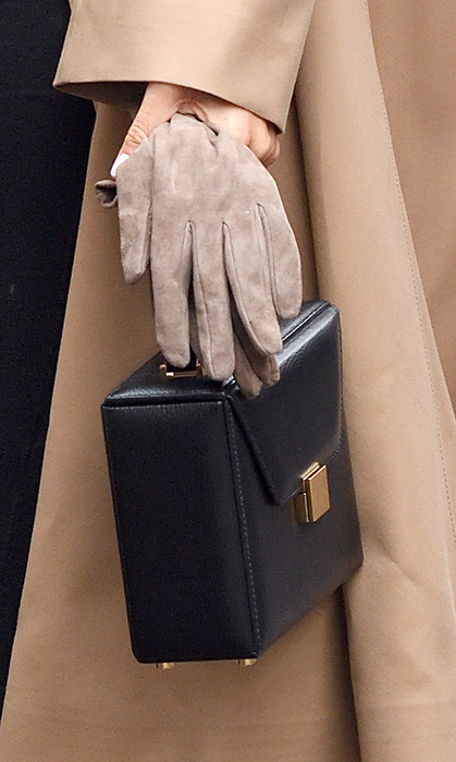 Holding on to a beautiful pair of suede camel gloves, she carried the elegant Vanity Box Bag by Victoria Beckham.