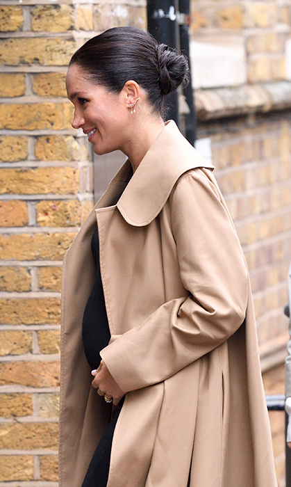 She may be the Duchess of Sussex, but she is the ultimate queen of coats! Meghan kept her growing baby bump warm in a chic Oscar de la Renta coat, and wore her hair up in her trademark bun.