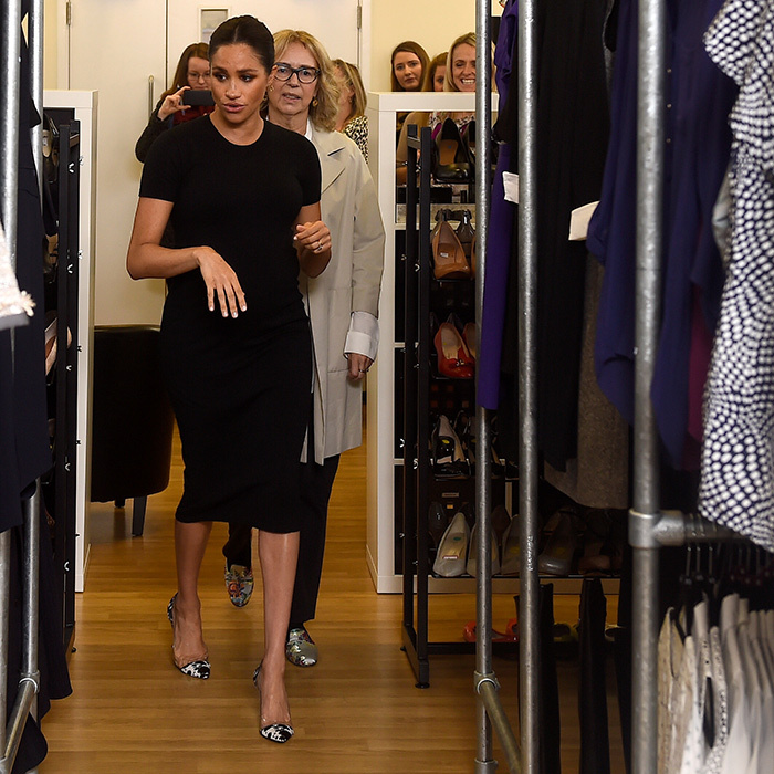 Meghan quickly got down to business, checking out all of the clothing options at Smart Works.