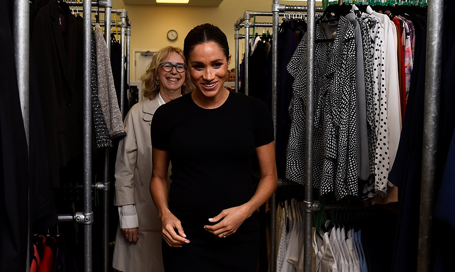 The expecting royal walked through racks of clothes with Lady Juliet Hughes-Hallett during her visit.