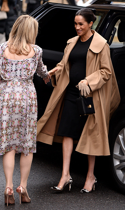 The Duchess of Sussex stepped out on Jan. 10 looking every inch the fashionable royal! For her first official outing of 2019 at Style Works, Meghan dazzled in an Oscar de la Renta trench coat, a black maternity dress by Hatch and a new pair of shoes for her – Gianvito Rossi cow-print plexi pumps! The pregnant royal accessorized with the 'Vanity Box Bag' by Victoria Beckham and a chic ear-climber earring by Kimai Felicity. She paired her engagement ring with the Missoma Interstellar Ring.