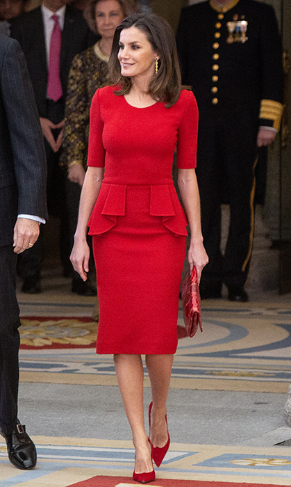 Queen Letizia looked radiant in red for the National Sports Awards in Madrid on Jan. 10! The queen of monochrome dazzled in a recycled Carolina Herrera stretch-wool peplum dress and carried the 'Maysa' bag by the designer, anchoring the look with her go-to Marit 'Liza' pumps in custom red suede. Dangling from her ears were her TOUS gold long shell earrings to seal the deal on this winning outfit.