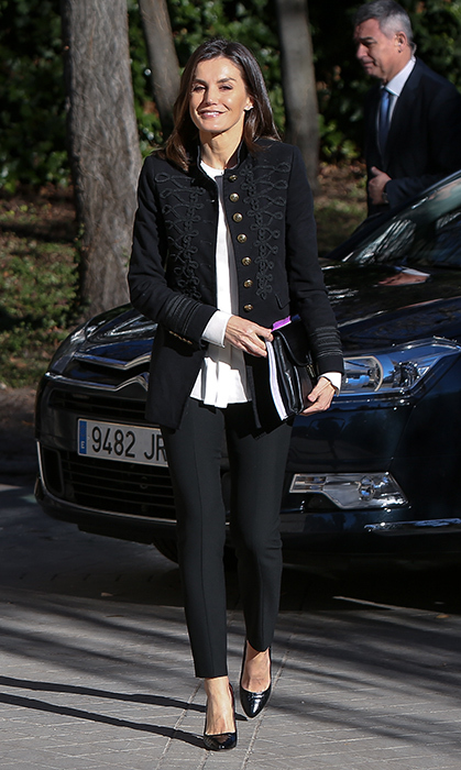 The Spanish Queen oozed cool in a military chic outfit for a meeting with the Foundation Against Drug Addiction in Madrid on Jan. 9. She dressed up her black-and-white ensemble with an embroidered jacket from Zara, her recycled white Hugo blouse and a pair of Hugo Boss slim-fit cropped 'Hervas' pants. She accessorized with the brand's 'Fanila' clutch and 'Staple R100-C' pumps, and glittered it up with the Gold & Roses 'Skyline' crawler earrings.