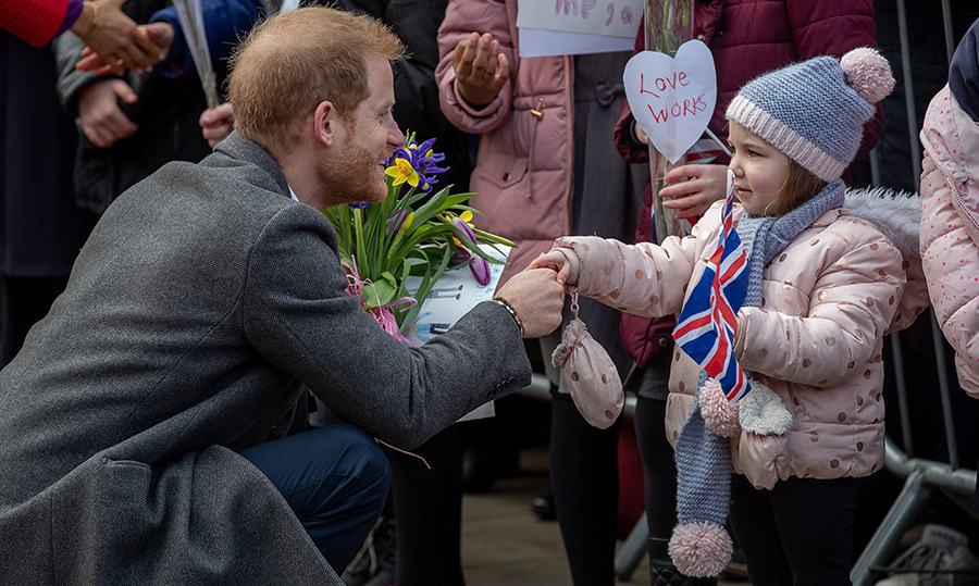 Showing off his natural charm, Prince Harry chatted with an adorable little girl in the crowd. 