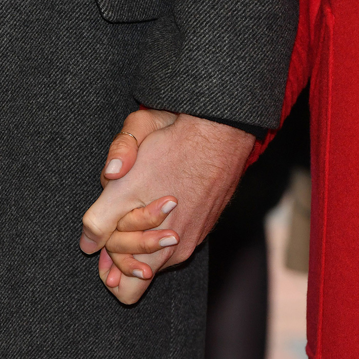 The couple held hands while walking through the new supermarket. Meghan showed off her new thumb ring by i & i.