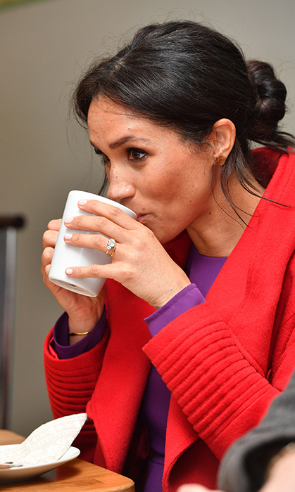 The Duchess of Sussex sipped on her tea, showing off her beautiful engagement ring.
