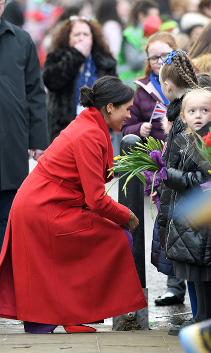 Duchess Meghan had her maternal side on full display while greeting adorable kids at Hamilton Square.