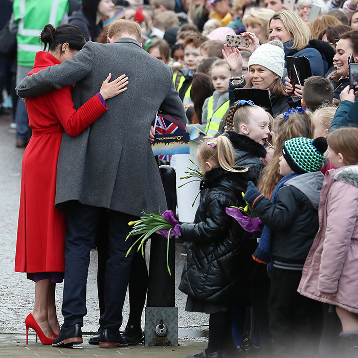 The couple shared a sweet side hug during the walkabout. One adorable girl looked <em>very</em> happy to be meeting the royal couple...