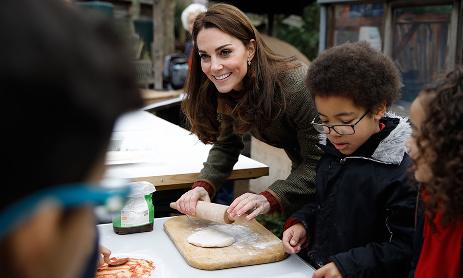 "The Duchess of Cambridge was game to get her hands dirty as she made pizza with the children, one of whom posed a hilarious question. ""Has the Queen ever eaten pizza?"" they asked, and Kate had a sweet response. ""That's such a good question, I don't know. Maybe next time I see her, shall I ask?""