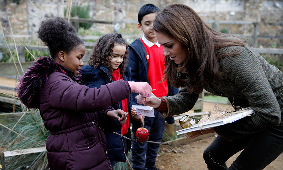"The duchess didn't leave empty handed! Seven-year-old Edwina gave her an bird feeder that the group had made earlier by sticking sunflower seeds into an apple, with a note reading, ""Kate [with a crown] love from Year 3 inclooding [sic] the teachers."" She also took home a book about birds and a jar of homemade honey!