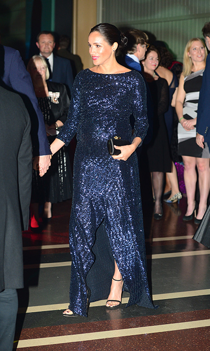 "Effortlessly moving between monochromatic perfection in an H&M mini dress and a cream Emporio Armani coat, she threw her hair up into the chicest bun and slipped into some sequins. Crafted by close friend Roland Mouret, she went with a navy-blue sequin gown (CA$5,700), paired with black Stuart Weitzman 'Nudist' heels, her Givenchy jewelled clutch and <a href=""/tags/0/princess-diana"" target=""_blank""><strong>Princess Diana</strong></a>'s heirloom bracelet, which <a href=""https://ca.hellomagazine.com/fashion/02018101647951/meghan-markle-princess-diana-earrings-bracelet-australia""><strong>she first wore in Australia</strong></a>.