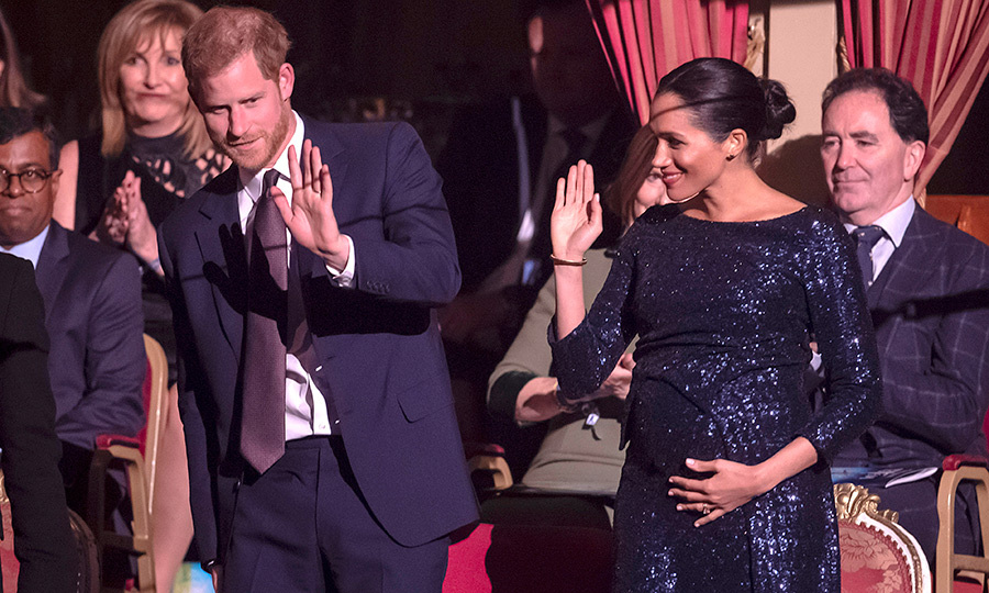 Prince Harry and Meghan waved from the stands.