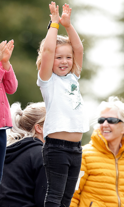 The little girl, who's mother is an avid equestrian, appeared to be thoroughly enjoying watching the horse trials!