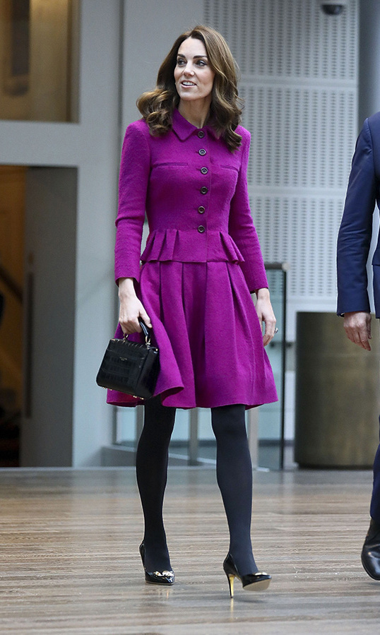 It was a colourful outing, indeed! Duchess Kate looked chic as ever for a visit to the costume department at the Royal Opera House on Wednesday (Jan. 15). The mother of three dazzled in a recycled purple Oscar de la Renta dress for her very artsy engagement.