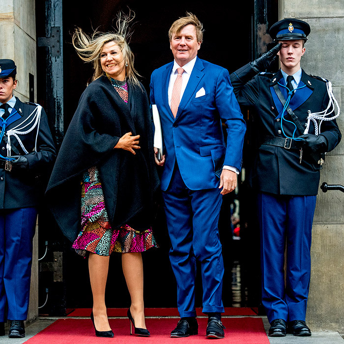 It was a windy day in the Netherlands, but Queen Máxima didn't let that interfere with her look! While attending the new year reception at the palace, the queen – dazzling in a chic black shawl, a colourful dress and black pump – was joined her husband King Willem-Alexander on Jan. 15.