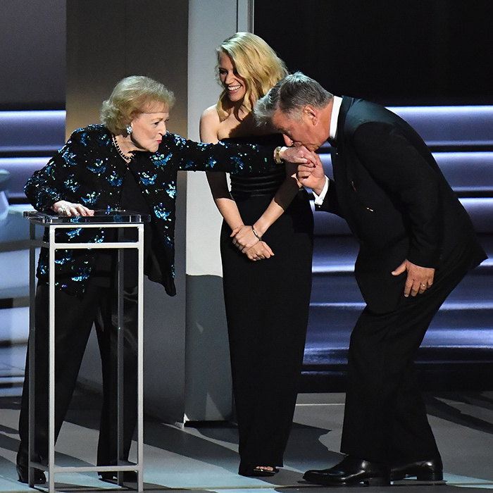 Still totally killin' it at age 96, Betty took to the stage to help present an award at the Emmys – and even some of Hollywood's biggest names, like funny woman Kate McKinnon and beloved actor Alec Baldwin, bow down to the icon.