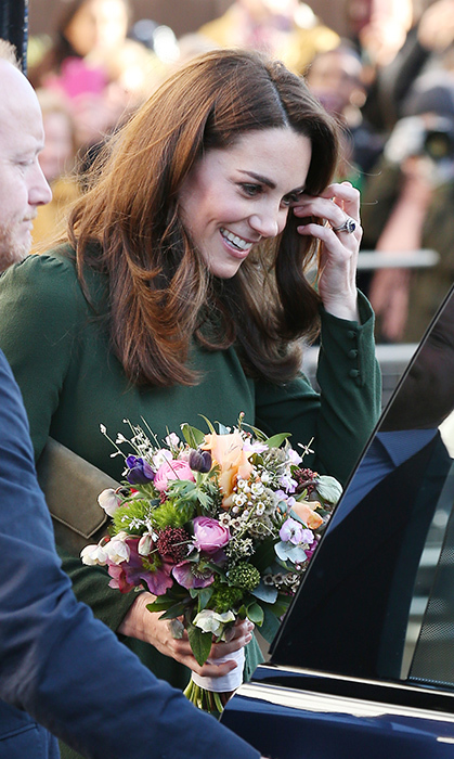 The duchess tucked a strand of hair behind her ear while getting into her car, showing off her stunning enagement ring.