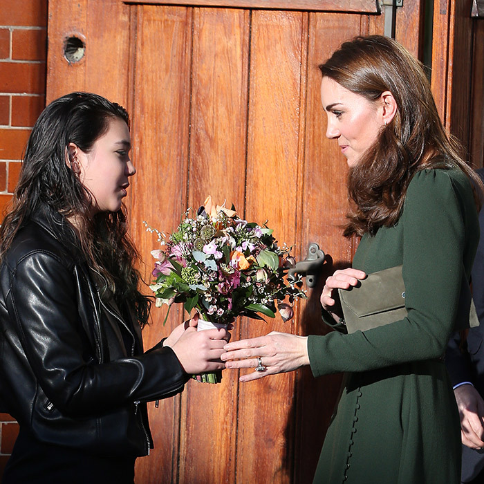 As Kate was leaving the charity, she was greeted by a sweet young girl, who handed her a beautiful bouquet of flowers.