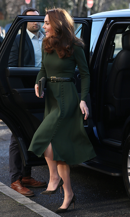 The stunning dress featured a slight side-slit and sweet buttons lining the side – a cut which perfectly flattered her slender frame. The duchess was quick to meet fans with a smile as she exited her car.