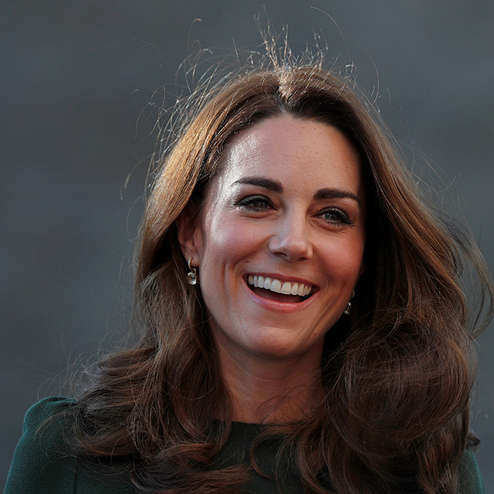Of course, her beauty look was absolute perfection, too. Wearing her brunette locks in her trademark bouncy curls, the duchess wore a strong brow, a subtle smoky eye and a beautiful peachy pink lip to seal the deal.