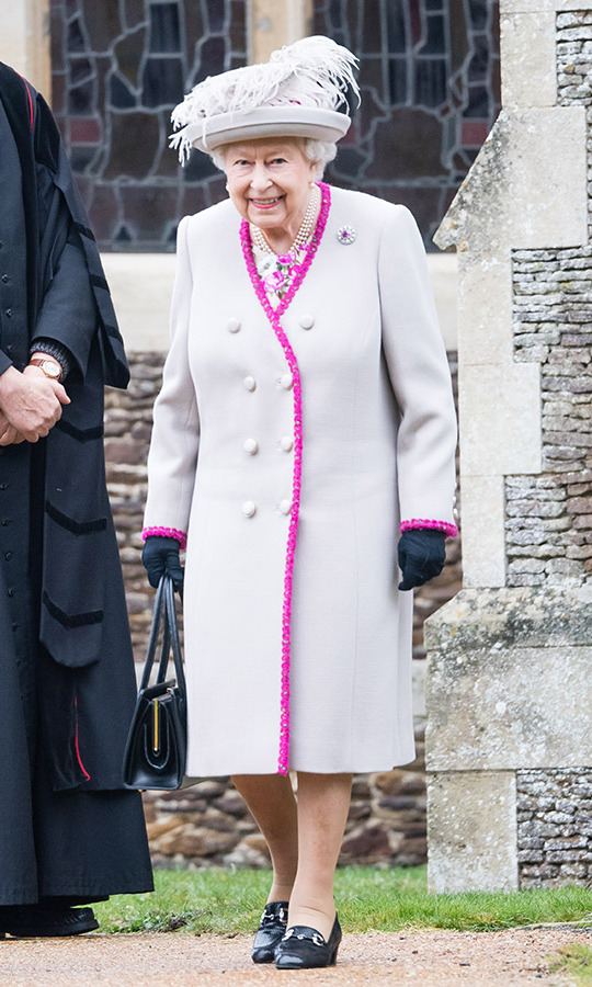 For Christmas Day services in 2018, the Queen paired a floral dress with a coat featuring a piping of pink flowers, and topped it all off with a fun feathered hat!