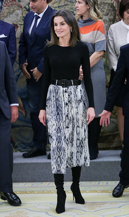 For a hearing at the palace on Jan. 18, the Spanish queen was the picture of chic in a black sweater and snakeskin-print skirt, accessorizing with a Zara snakeskin belt and her 'Francesca' black over-the-knee boots by her go-to footwear designer, Magrit.