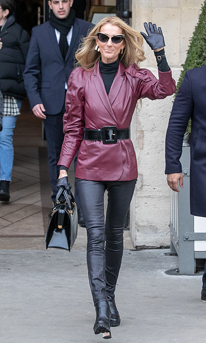 "Leather was the word for the ""My Heart Will Go On"" singer, who strutted her stuff in the luxe fabric from head to toe. A mix of maroon and black, with cat-eye sunglasses and gloves, Celine made a statement with her motorcycle-chic ensemble!