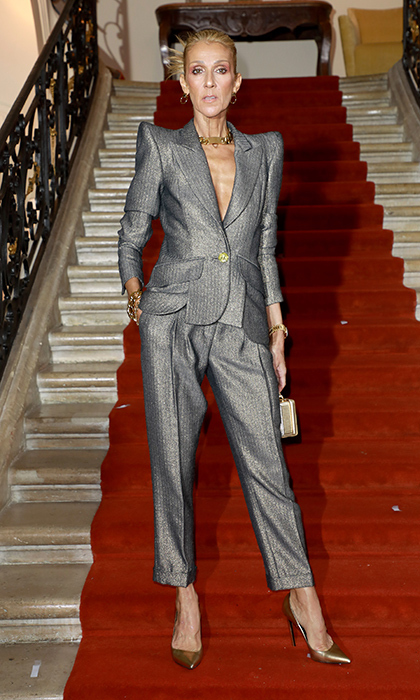 Strike a pose! Celine did just that on the steps leading into the RVDK Ronald Van Der Kemp show. She looked perfectly futuristic in a silver suit with the fiercest of accentuated shoulders and metallic accessories.