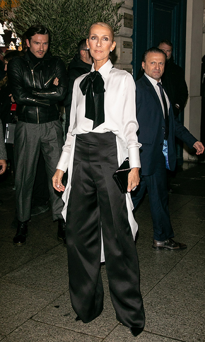 Later on that evening, the 50-year-old traded in her glitzy dress for a chic two-tone ensemble at the Armani Privé show! And clearly, we aren't the only ones who admired her outfit ... Pepe did, too! She looked her typically elegant self in flared satin black pants and a white top boasting a large black bow.