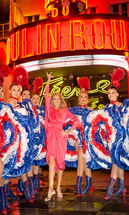 Where there's colour and drama, there's Celine – in the best way! The award-winning singer stopped for a photo with dancers of The Moulin Rouge, dazzling in a pink dress and metallic sandals.