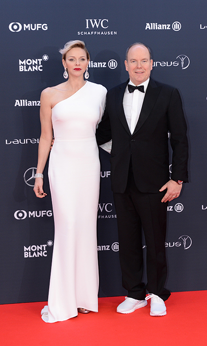 Princess Charlene looked wonderful in white for the 2018 Laureus World Sports Awards at Salle des Etoiles in February 2018! The Monaco royal dazzled in a one-shoulder gown, pairing the look with dangling earrings and a deep berry lip.