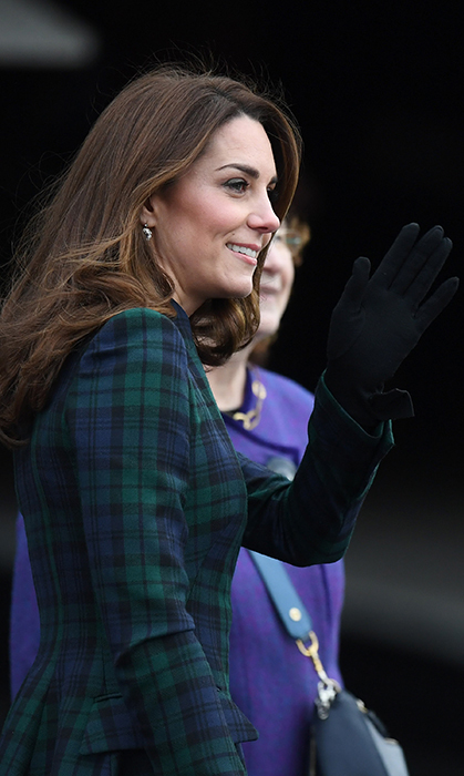 The Duchess of Cambridge looked every inch the style star, dazzling in an appropriately tartan coat dress – one of her favourite styles. She accessorized with a pair of black gloves and drop earrings, keeping her brunette hair in her signature bouncy waves.