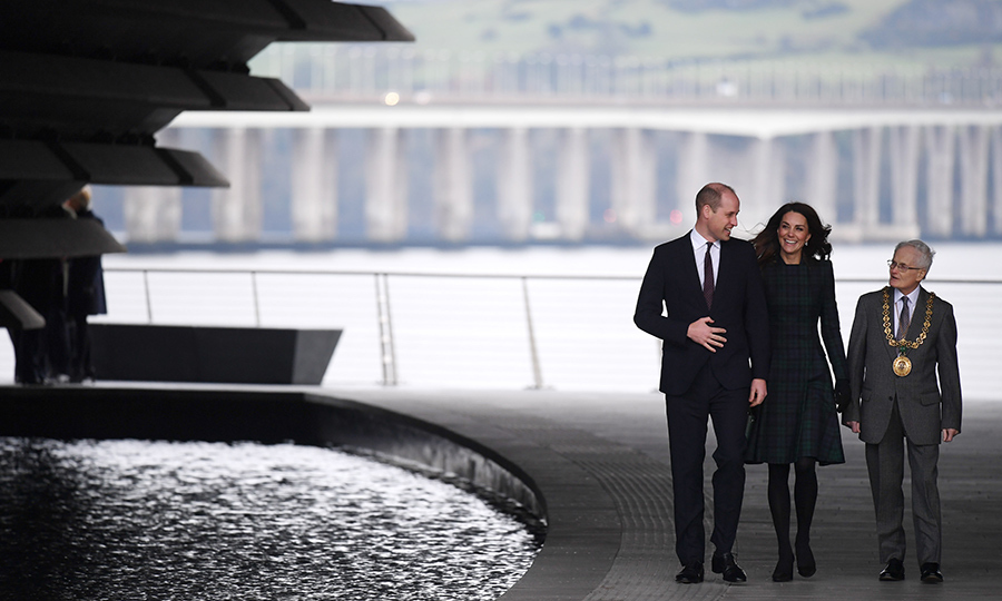 The couple wandered around the beautiful museum grounds alongside an official. They appeared to be in a rather animated conversation that certainly got Kate laughing!