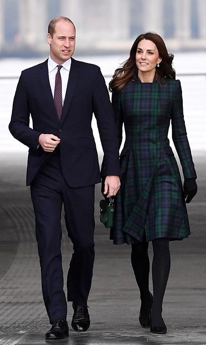 The Cambridge couple made quite the dapper duo, with William looking handsome in a navy-blue suit and tie, and Kate looking no further than one of her go-to styles, the coat dress. She recycled her blue-and-green Alexander McQueen tartan, paired with opaque black tights and suede pumps. She also carried a sweet green handbag for the outing.