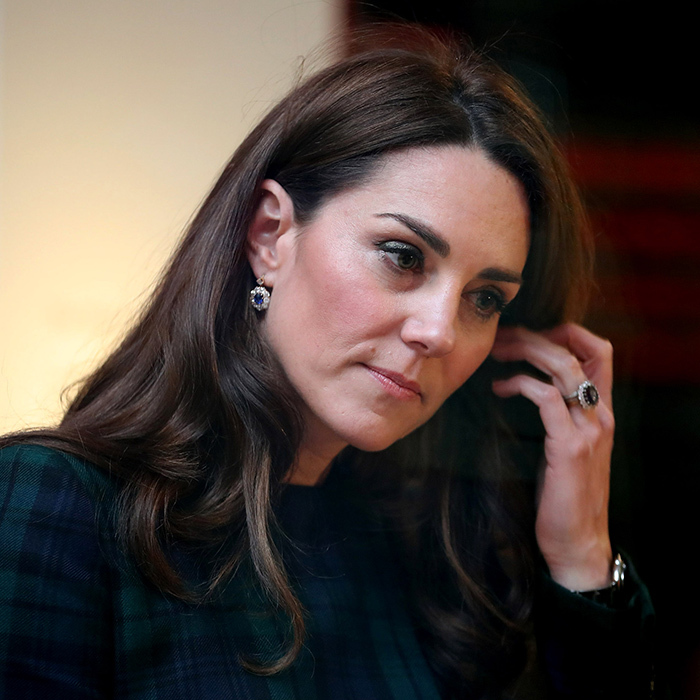 The duchess showed off her jaw-dropping engagement ring as she tucked her hair behind her ear.