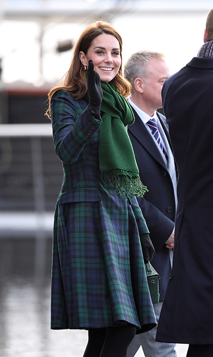 It was a bit chilly in Scotland, so Kate threw on a kelly green scarf to keep her neck warm.