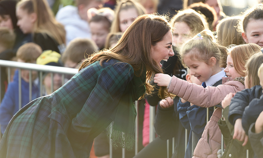 One little girl reached out the touch the duchess's beautiful hair – and Kate had quite the laugh!